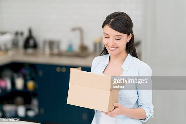 Latin American woman getting a parcel in the mail
