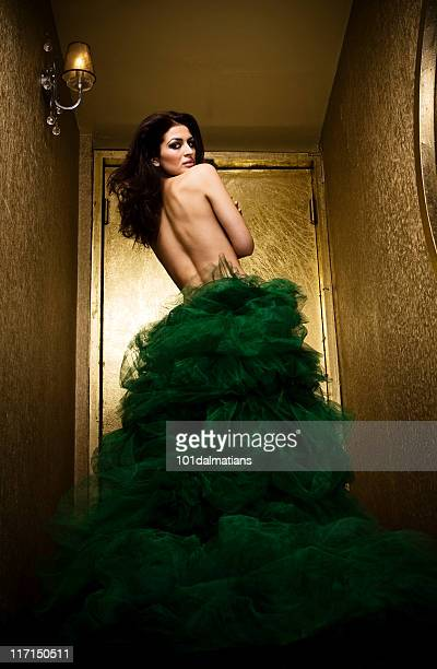latin beauty - green dress stock pictures, royalty-free photos & images