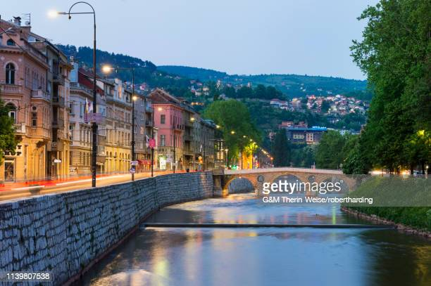 latin bridge at sunset in sarajevo, bosnia and hercegovina, europe - sarajevo stock-fotos und bilder