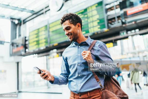latin businessman traveling for a meeting - business travel stock pictures, royalty-free photos & images