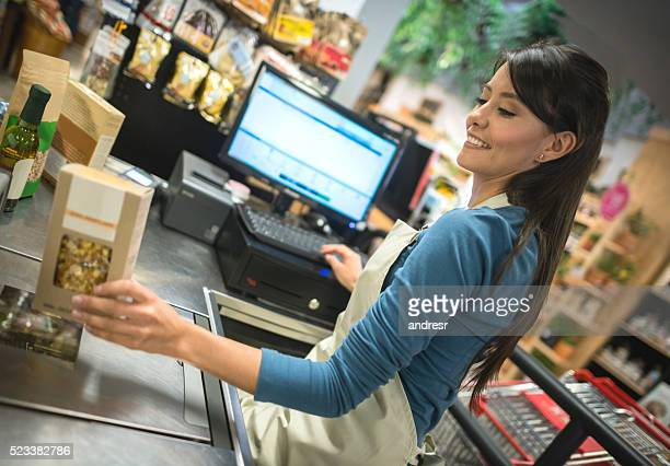 latin cashier working at a supermarket - cashier stock pictures, royalty-free photos & images