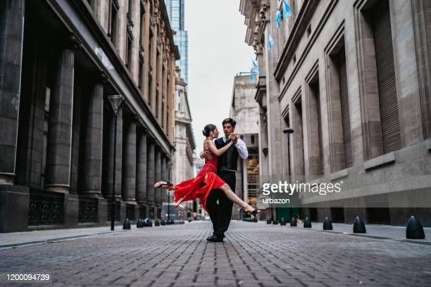 latin couple dancing tango on city street - argentina stock pictures, royalty-free photos & images