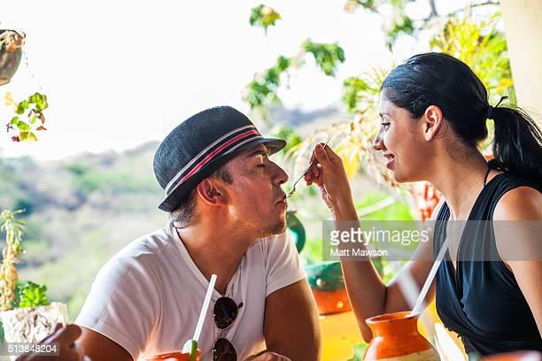 A latin couple in a rural restaurant restaurant