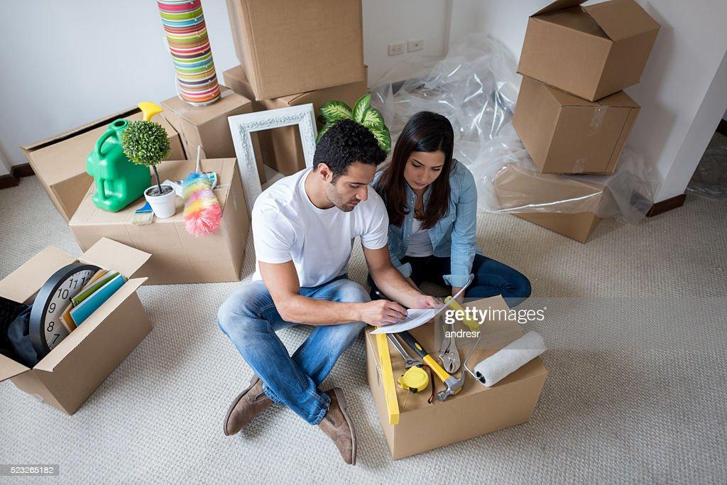 Latin couple moving house : Stock Photo