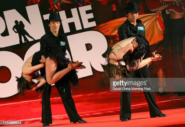 Latin dancers Daisy Chow Ying Paul Yu Puilam Kniki Kwan Kitwan and Joey Shen Jessie give an open performance at a shopping plaza to promote latin...