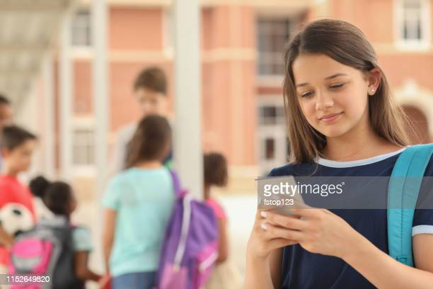latin descent, high school age girl on school campus. - junior high student stock pictures, royalty-free photos & images