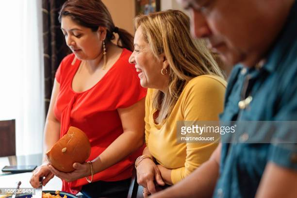 Latin family American carving pumpkins for Halloween