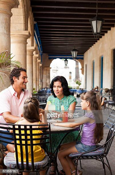 Latin family in restaurant