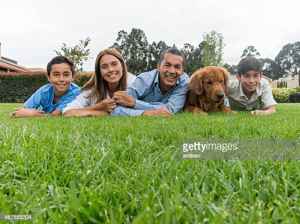 Latin family looking happy outdoors