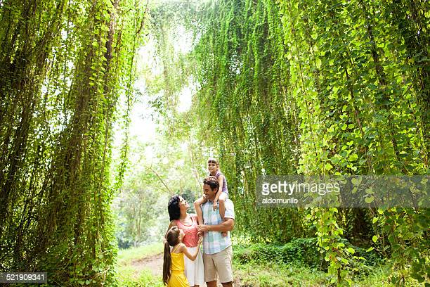 Latin family talking in jungle