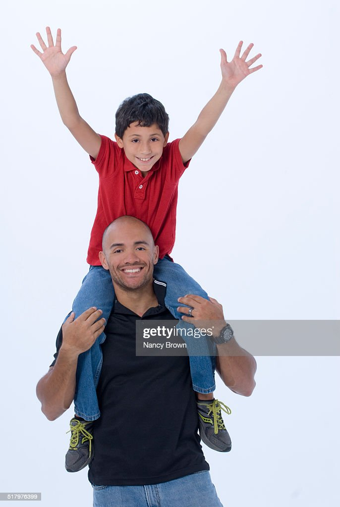 latin father ten year old son very happy stock photo getty images