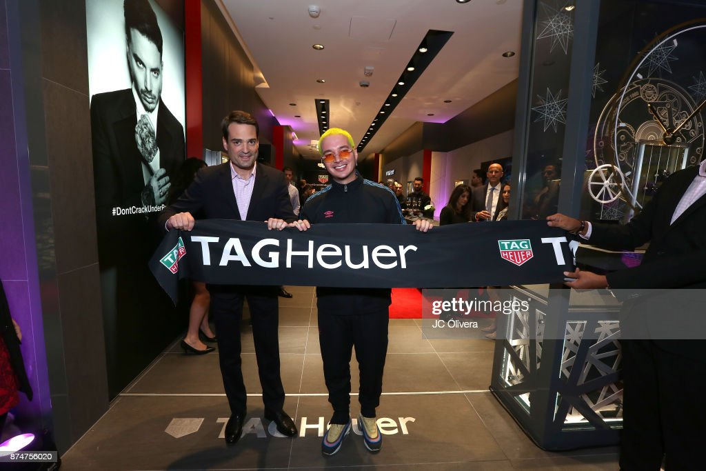 Latin Grammy Winner and TAG Heuer ambassador J Balvin (R) and Kilian Muller TAG Heuer North America CEO attend the grand opening of the new TAG Heuer Boutique at The Forums Shops at Caesars Palace on November 15, 2017 in Las Vegas, Nevada.