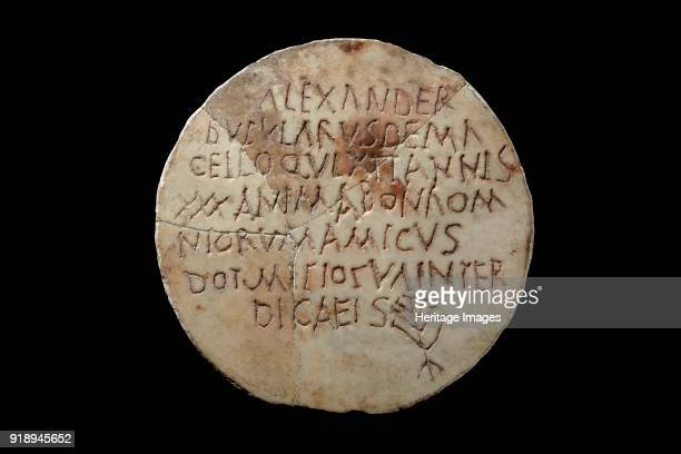 Latin inscription 3rd4th century Circular marble inscription with seven Latin lines 'Alexander sausageseller in the market who lived 30 years a good...