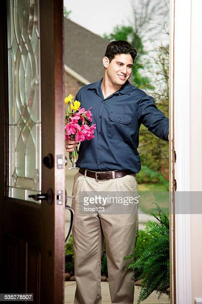 Latin man delivering flowers for Mother's Day or Valentine's. Door.