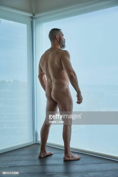 Latin Man in Corner Nude