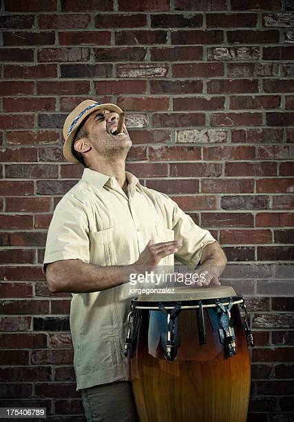 Latin man playing conga