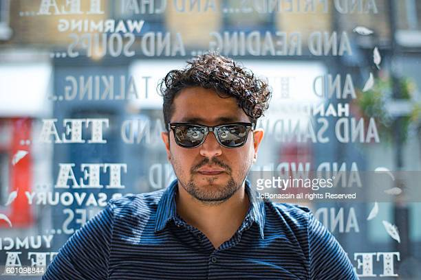 latin man with sunglasses - jcbonassin stock pictures, royalty-free photos & images