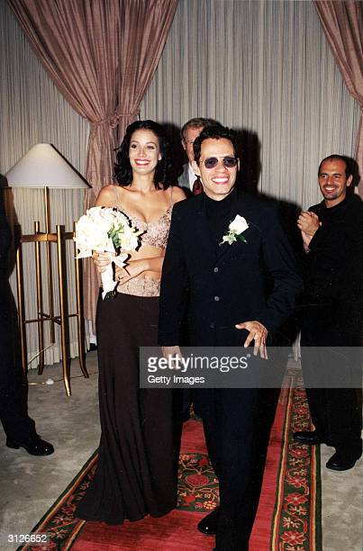 Latin pop singer Marc Anthony and former Miss Universe Dayanara Torres smile on their wedding day in Las Vegas Nevada May 9 2000 The couple had...