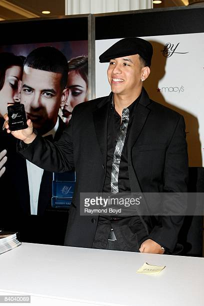 Latin rapper Daddy Yankee poses with his new fragrance DY at Macy's on State Street in Chicago Illinois on December 12 2008