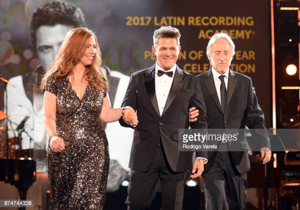 Latin Recording Academy Chair of the Board of Trustees Laura Tesoriero honoree Alejandro Sanz and Recording Academy President/CEO Neil Portnow walk...