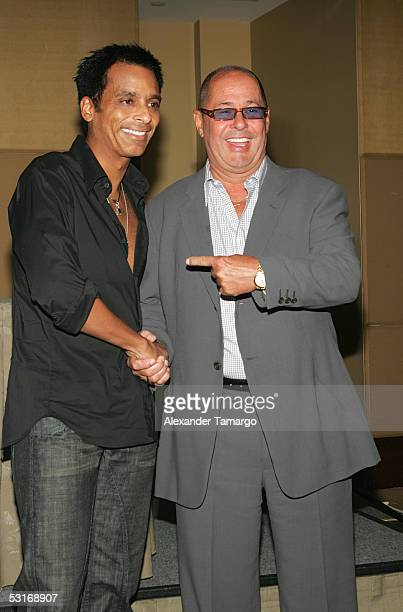 Latin recording artist Jon Secada poses with Bill Edwards Chairman/CEO of Big3 Entertainment at the Mandarin Oriental Hotel June 29 2005 in Miami...