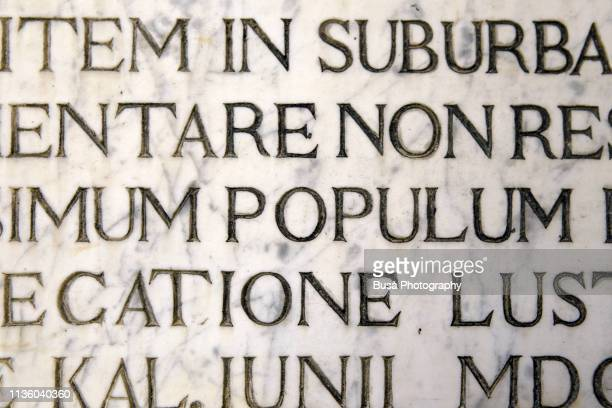 latin script engraving on marble as seen on a wall in venice, italy - carving craft product stock pictures, royalty-free photos & images