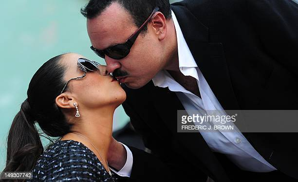 Latin singing star Pepe Aguilar kisses his wife Aneliz Alvarez de Aguilar on arrival for the unveilng of his Star on the Hollywood Walk of Fame on...