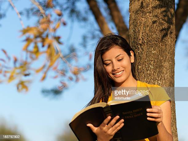 Latin teenager reading the Bible