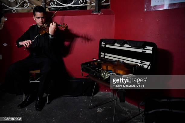 A Latin Vox Machine orchestra member prepares backstage before performing at a theater in Buenos Aires on October 09 2018 Latin Vox Machine is an...
