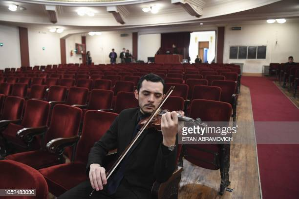 A Latin Vox Machine orchestra member rehearses before a concert at a theater in Buenos Aires on October 09 2018 Latin Vox Machine is an orchestra of...