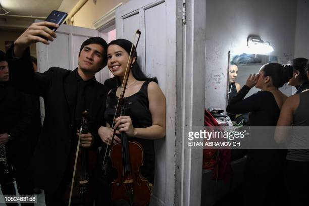 Latin Vox Machine orchestra members pose for a selfie backstage before performing at a theater in Buenos Aires on October 09 2018 Latin Vox Machine...