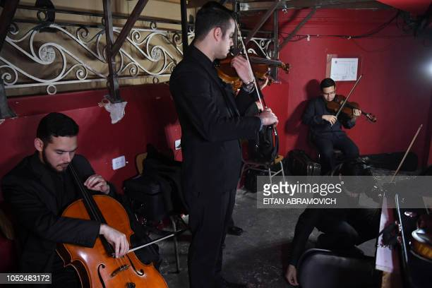 Latin Vox Machine orchestra members prepare backstage before performing at a theater in Buenos Aires on October 09 2018 Latin Vox Machine is an...