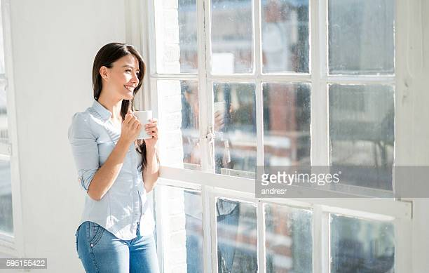 Latin woman at home drinking coffee