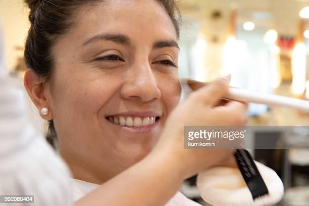 Latin woman at Kimono beauty salon