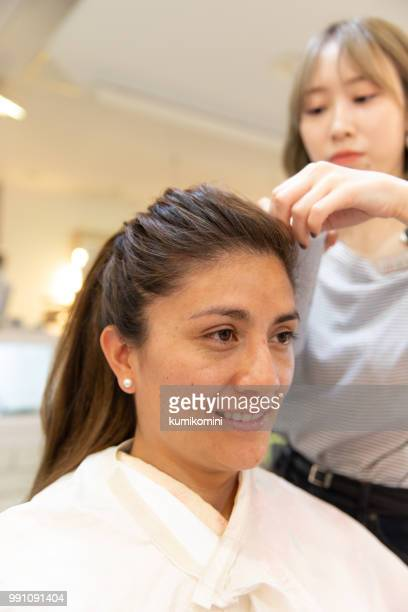 Latin woman having hair done