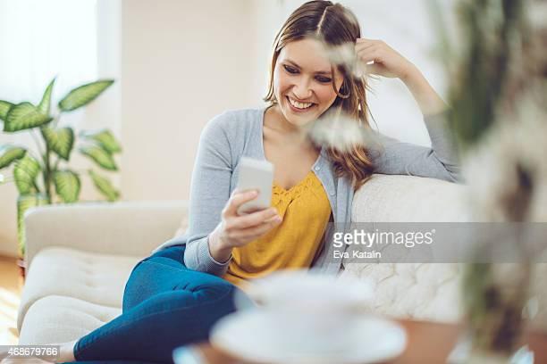 Latin woman texting at home