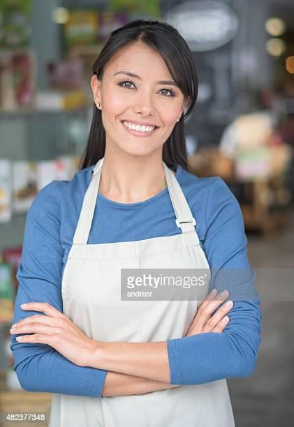 Latin woman working at a market
