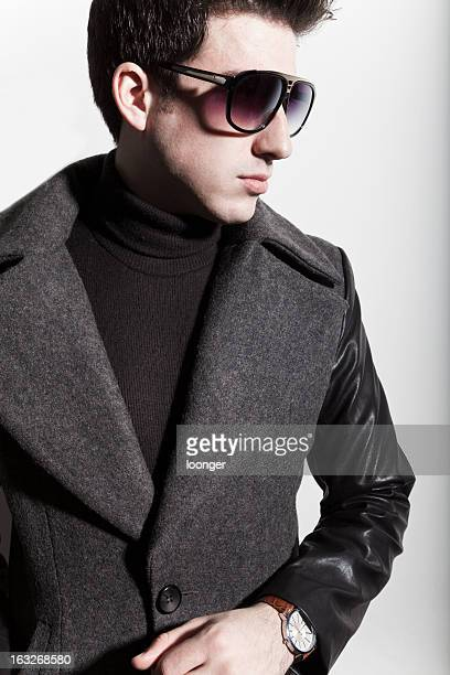 latin young man - long coat stock pictures, royalty-free photos & images