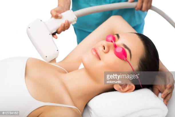 Latin young woman during hair removal treatment