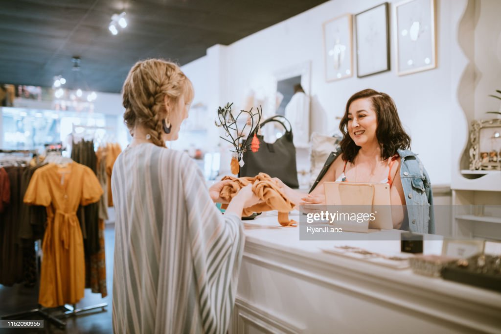 Latina Boutique Store Owner At Checkout Counter : Stock Photo
