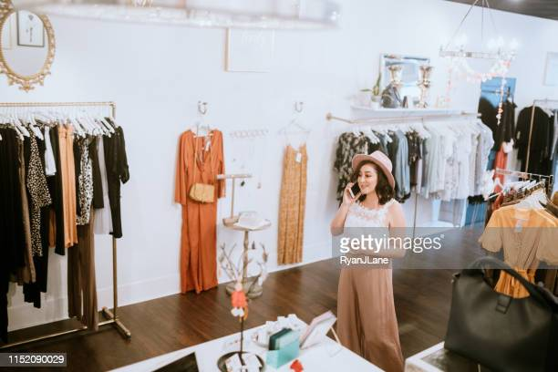 latina boutique store owner hard at work - womenswear stock pictures, royalty-free photos & images