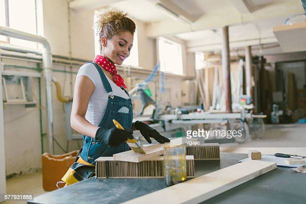 Latina Carpenter Painting Plank.