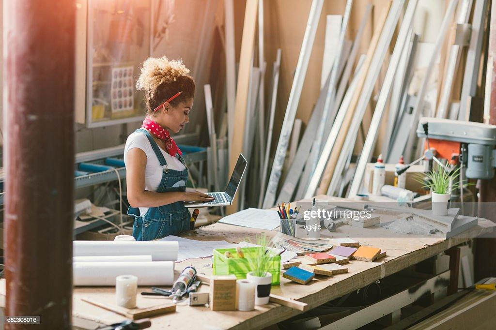 Latina Carpenter Standing In Her Workshop : Stock Photo