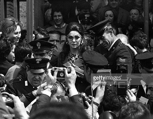 Latina Italy 14th April 1971 Italian actress Gina Lollobrigida is mobbed by the press police and her fans as she leaves a court after seeking a...