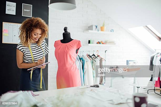 latina tailor in her workshop - fashion designer stock photos and pictures