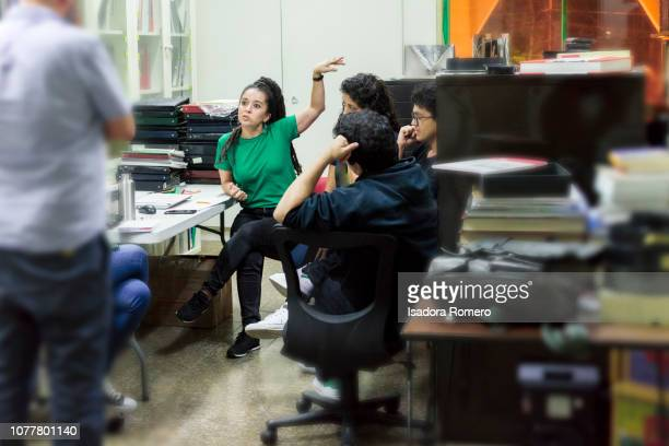 Latina woman working at the offfice in a meeting