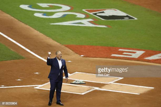 Latinborn member of the Baseball Hall of Fame Ivan Rodriguez takes the field with others to throw out the ceremonial first pitch at the start of the...