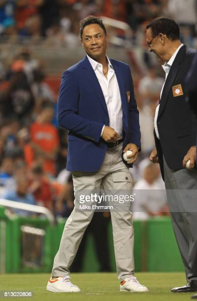 Latinborn member of the Baseball Hall of Fame Roberto Alomar takes the field with others to throw out the ceremonial first pitch at the start of the...