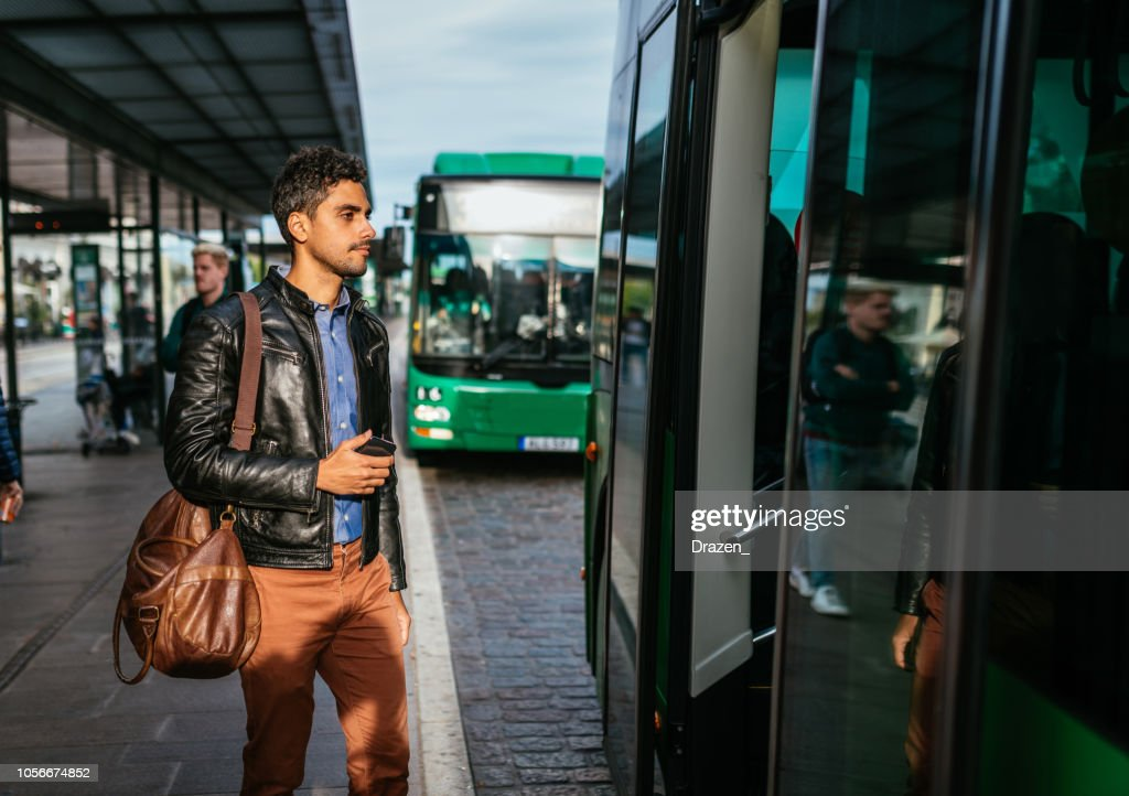 Latino Adult Businessman Going To Work By Public Bus High-Res ...