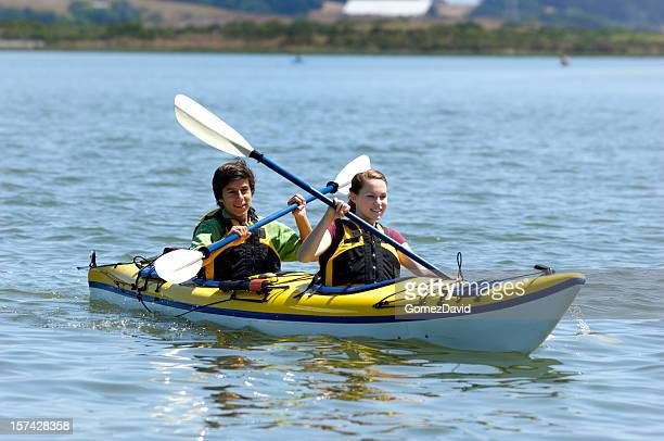 Latino and Caucasian Teenagers Kayaking on Body of Water